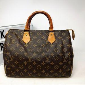 Louis Vuitton Speedy 30 Monogram top handle bag